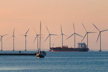 Windmils, cargo vessel, boat ship, Copenhagen Denmark