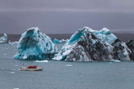 Huge iceberg and resque boat in Iceland Jokulsarlon