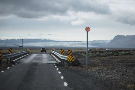 Icelandic road over the bridge summer season Reklamní fotografie