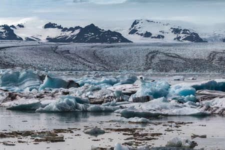 Melting tongue of the Breidamerkurjokull glacier summer season blue icebergs Reklamní fotografie