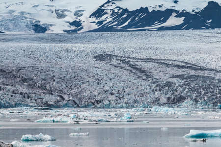 Melting tongue of the Breidamerkurjokull glacier summer season white ice