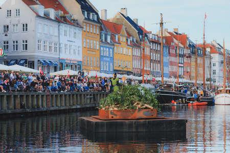 Copenhagen, Zealand / Denmark - June 23 2019: The witch in the middle of Nyhavn canal during Saint Johns Eve celebration in Copenhagen