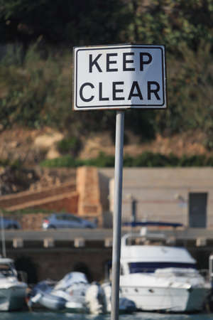 Keep clear road sign on blur background, vertical