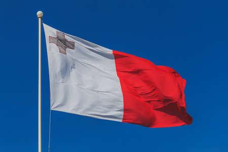 Malta national flag is waving in deep blue sky background