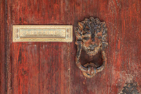 Antique door knock in Valletta Malta on old doors and hole for letters, Lettere - Leters