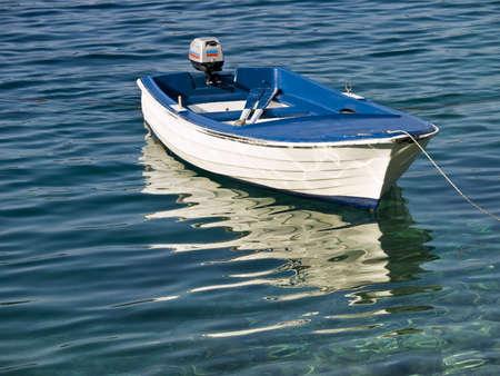 Plastic mediterranean style boat in the adriatic sea. Shot in Croatia. photo