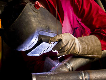 metal pipe: Welder in action.