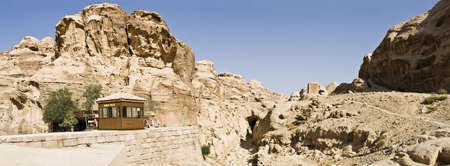 remains: Panoramic landscape of main ancient aqueduct in Petra - Nabataeans capital city (Al Khazneh) , Jordan. Also tourist police house on the left.