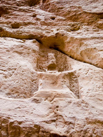 remains: Nabatean place of worship (gods Dushara or al-Uzza)  in Petra (Al Khazneh), Jordan.  Carved in red rock. Ruins in the Siq canyon from Roman empire time.