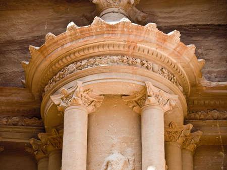 nabatean: Treasury temple entrance facade detail of Nabatean temple or tomb in UNESCO site Petra (Al Khazneh), Jordan. Siq canyon.