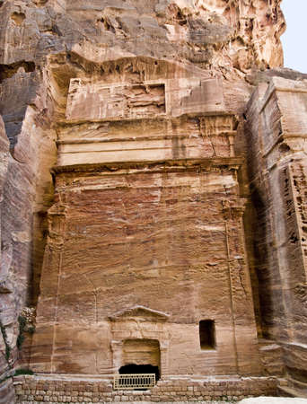 remains: Tombs in Petra - Nabataeans capital city (Al Khazneh) , Jordan. Made by digging a holes in the rocks. Roman Empire period.