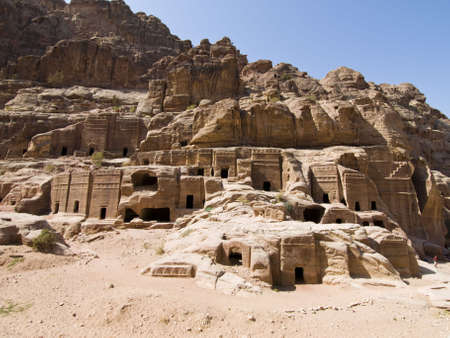 khazneh: Small tombs in Petra (Street of Facades part) - Nabataeans capital city (Al Khazneh) , Jordan. Made by digging a holes in the rocks. Roman Empire period. Stock Photo