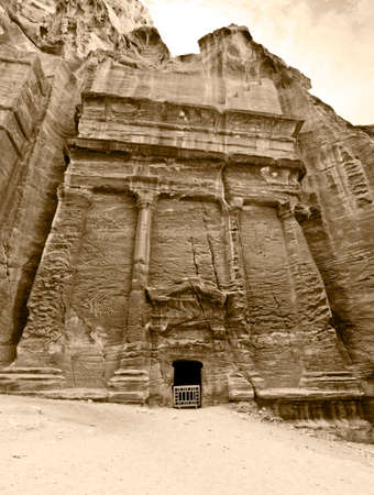 nabataeans: Tombs in Petra (Street of Facades part) - Nabataeans capital city (Al Khazneh) , Jordan. Made by digging a holes in the rocks. Roman Empire period. Color sepia tone. Stock Photo