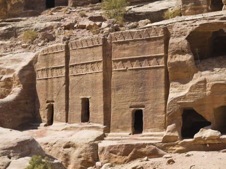 nabataeans: Small tombs in Petra (Street of Facades part) - Nabataeans capital city (Al Khazneh) , Jordan. Made by digging a holes in the rocks. Roman Empire period. Stock Photo