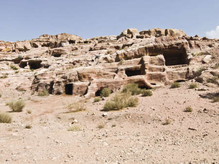 remains: Landscape - Nabataeans capital city (Al Khazneh) , Jordan. Made by digging a holes in the rocks. Roman Empire period. Stock Photo