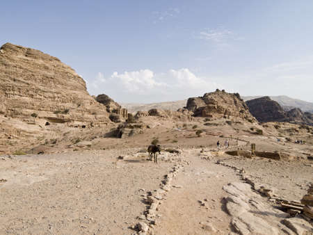 remains: Landscape of Petra with Monatary and donkey - Nabataeans capital city (Al Khazneh) , Jordan. Stock Photo