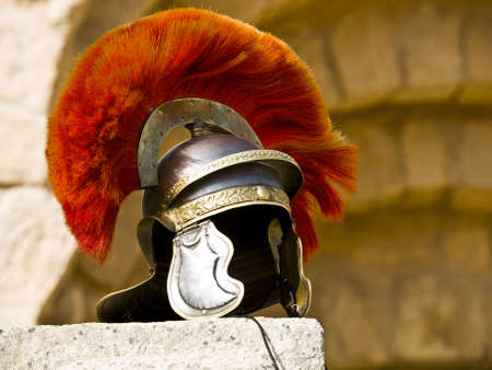 Roman Legionars helmet on the wall with arches in Jerash, Jordan Stock Photo