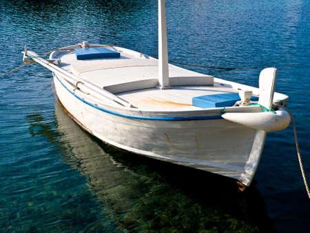 Traditional wooden boat on the island Lastovo, Croatia photo