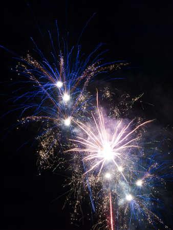 Fireworks rockets exploding against dark sky. photo