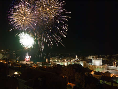 Opening of the Dubrovnik summer festival with big firework. Lot of small and big boats around the city. photo