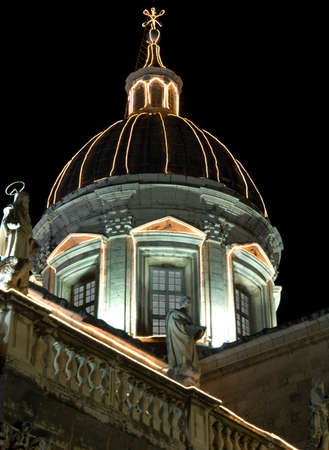 Dubrovnik old city walls details at night with outline lighting. Cathedral. photo