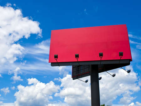 High red billboard against a blue sky photo