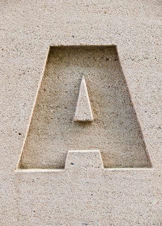 Una carta tallada en un bloque de piedra. Foto de archivo - 3500530
