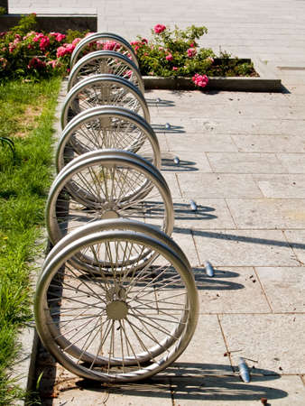 Bicycle parking made of aluminium metal wheels Stock Photo - 3609182