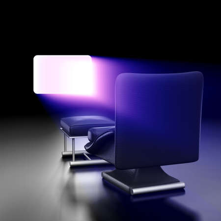 Watching a screen casting a blue light almost spiritual with leather sofa photo