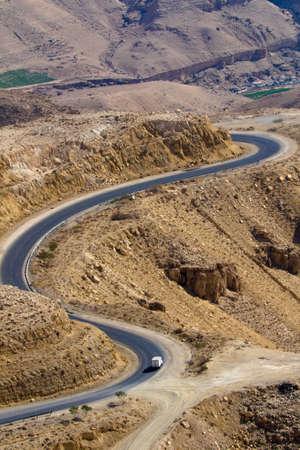 wadi: Wadi Mujib - King s road area, curvy highway with desert landscape in Jordan.