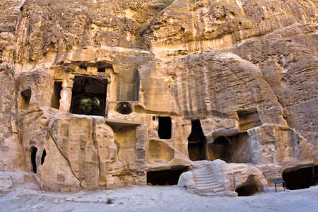 nabataeans: Tombs in Little Petra - Nabataeans capital city (Al Khazneh) , Jordan. Made by digging a holes in the rocks. Roman Empire period. Stock Photo