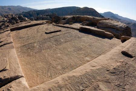 khazneh: High Place of Sacrifice in Petra, Jordan. Nabataeans capital city (Al Khazneh). Made by digging the rocks. Roman Empire period. Stock Photo