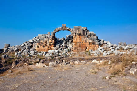 Pompey made Apamea (Apameia) or Afamia (Arabic) part of the Roman Empire in Syria. Cardo maximus street end with arch. Roman and Byzantine period photo