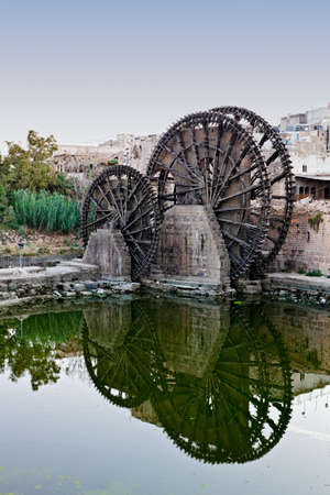 Hama (ancient Hamath). Part of 17 ancient wooden norias (1100 BC) on Orontes River used for watering the gardens photo