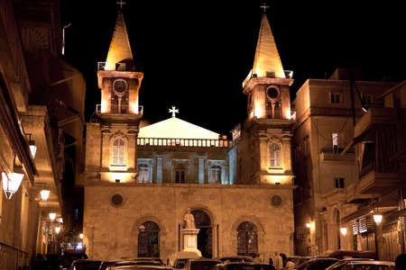 maronite: Maronite Church in Aleppo, Syria, with two towers and old sculpture in front.