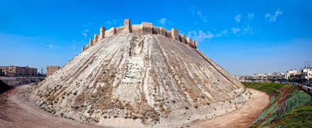 inhabited: Famous fortess and citadel in Aleppo, Syria. One of the oldest inhabited cities in the world. East side wall panorama.