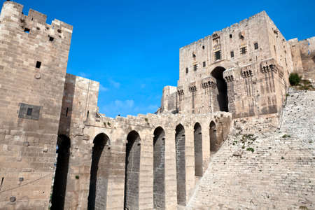 Famous fortess and citadel in Aleppo, Syria. One of the oldest inhabited cities in the world. Entrance bridge. photo