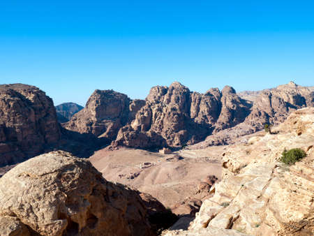 Jordan Petra desert panorama with a toms in the distance and blue sky above. Roman temple in front Stock Photo - 6838606