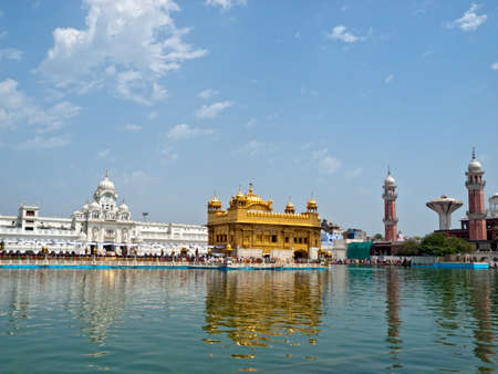 punjab: Golden Temple. Holiest shrine of the Sikh religion. Ornate gold covered building in the middle of an artificial lake in Amritsar, Punjab, India.