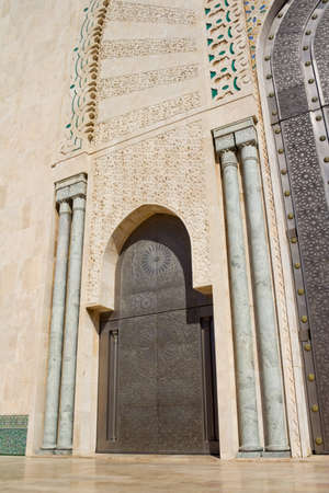 Exterior of Hassan II mosque with blue sky and cloudscape background, Casablanca, Morocco. photo