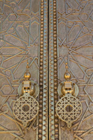 fes: Detail of Old Golden Door in the Royal Palace in Fes (Fez), Morocco.