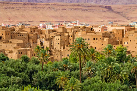 mountain oasis: Panorama of a village in Moroccan hills, Morocco, thousand Kasbah road. Oasis in Sahara desert area