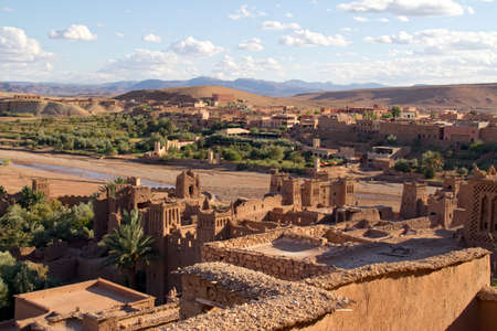 Fortified City (Ksar) with Mud Houses in the Kasbah Ait Benhaddou near Ouarzazate against new village, Morocco. Souss-Massa-Draâ region. Ounila River. UNESCO World Heritage Site since 1987 Stock Photo - 10853736