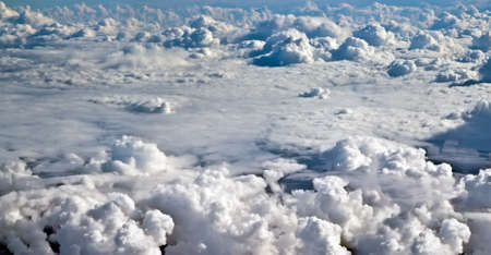 Airplane shot above clouds. photo