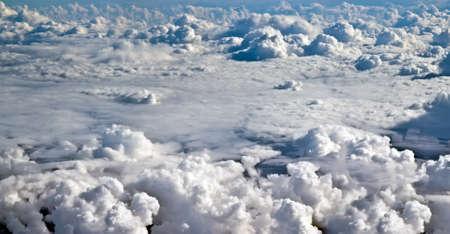 cloudscape: Airplane shot above clouds.