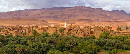 Panorama of a village in Moroccan hills, Morocco, thousand Kasbah road. Oasis in Sahara desert area photo