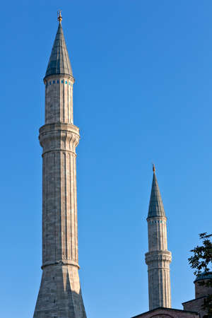 Blue mosque detail with minaret, Istanbul, Sultanahmet park. The biggest  mosque in Istanbul of Sultan Ahmed (Ottoman Empire). photo