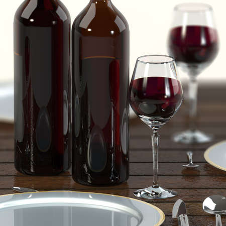 Glass of red wine with bottles on a wooden table. Stock Photo