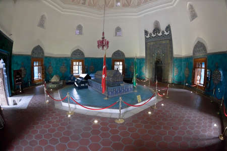 Interior of Green Mausoleum in Bursa with The sarcophagus of Sultan Mehmet I decorated with floral designs and calligraphic inscriptions. Fish-eye shot.
