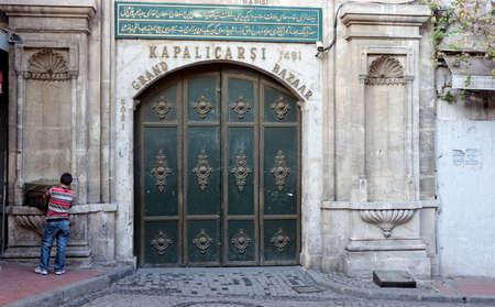 kapalicarsi: ISTANBUL, TURKEY - OCTOBER 1: Main entrance gate of the famous and largest street maket Kapalicarsi before opening on October 1, 2011 in Istanbul, Turkey.